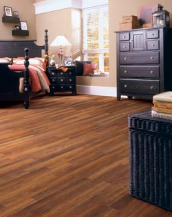 brown laminate flooring in bedroom - bed - dresser