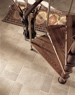 luxury vinyl flooring - bottom of circular stairway - area rug